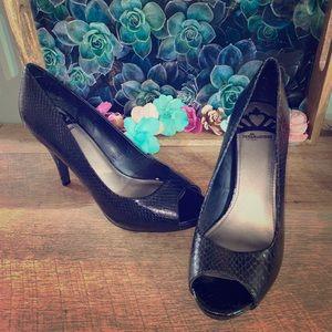 Black open toe heels. Size 8.5M.